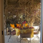 A seat at the table awaits, but the sliding glass door is a barrier