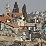 Green Hamas flags whip in the wind over Jerusalem's Old City